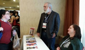 April MacDicken and me visiting with a fan on Sunday afternoon at Mysticon